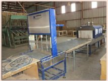 AUTOPACKER & COMBIPACKER WITH ROLLER TABLE
