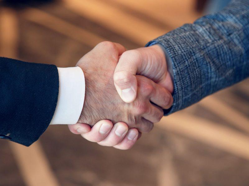 men-shake-hands-at-business-meeting-NE3Z7Y5 (1)